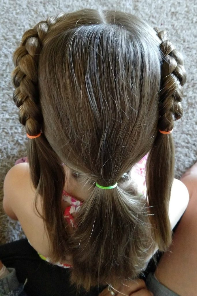 Braids are an easy way to keep her hair back and add a little style and this easy Rapunzel braid might be one of my new favorite hairstyles!