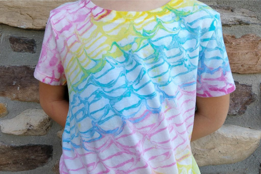 This rainbow mermaid shirt is a fun twist on the traditional tie dye method and was made using a marbling kit to create the unique mermaid scale pattern.  Such a cute way to celebrate the mermaid lover in your life!