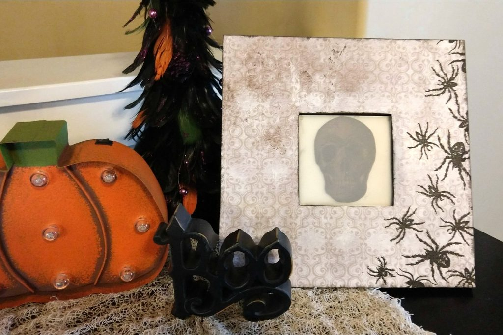 A spooky skull makes this framed art a perfect addition to your Halloween decorations!