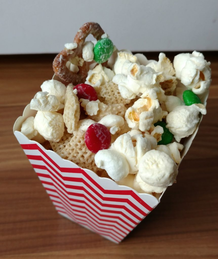 The best popcorn snack mix with yummy white chocolate, popcorn, m&ms and pretzels.