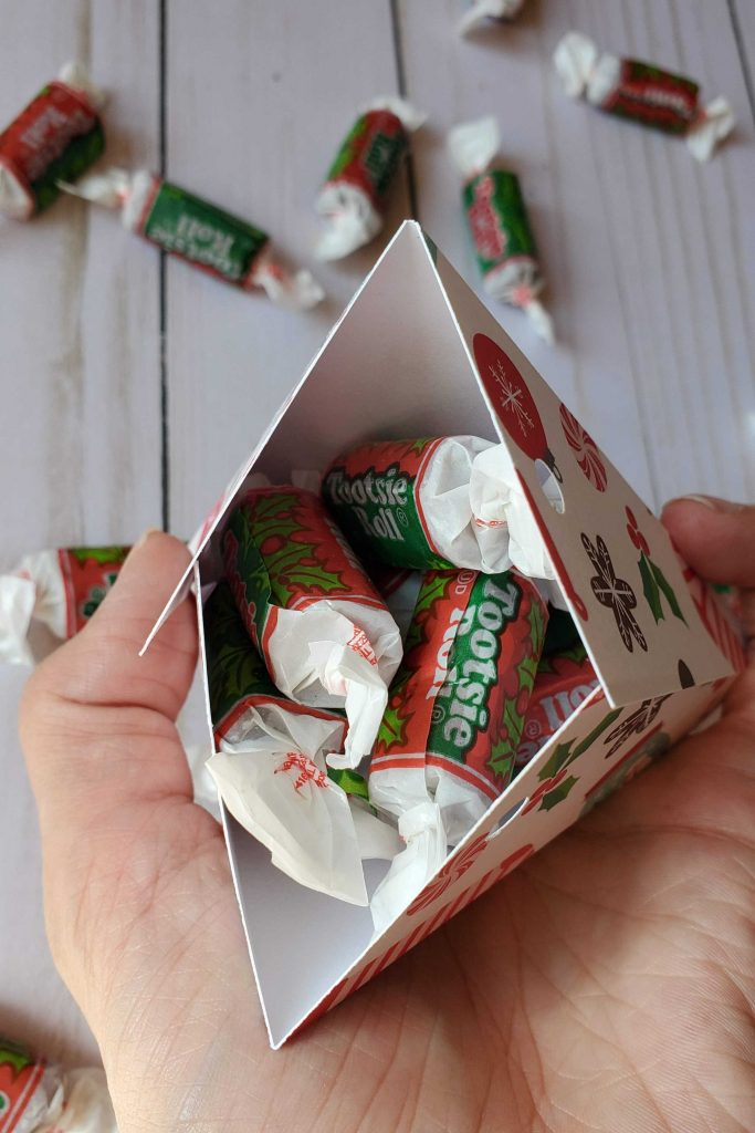 These DIY triangle treat boxes are so easy to make and perfect to give out as party favors, thank you gifts or just because.  Change up the paper you use and make these treat boxes for any occasion!