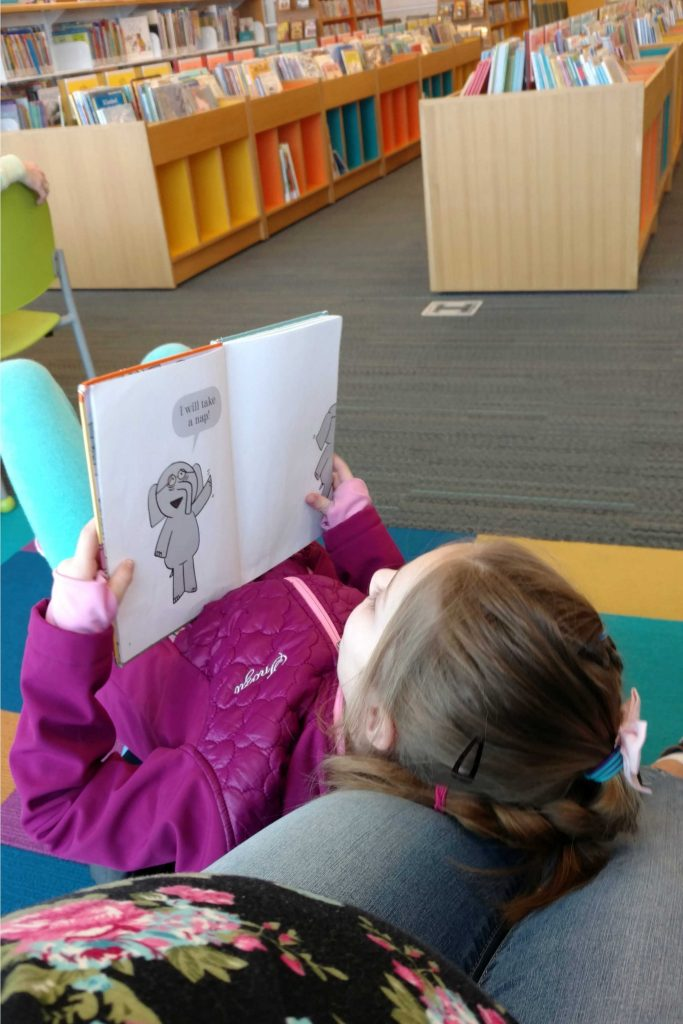 """These 9 tips will help your child become a better, more fluent reader, allowing their skills to increase and boost their confidence. (Spoiler: It's more than just """"sound it out"""".)"""