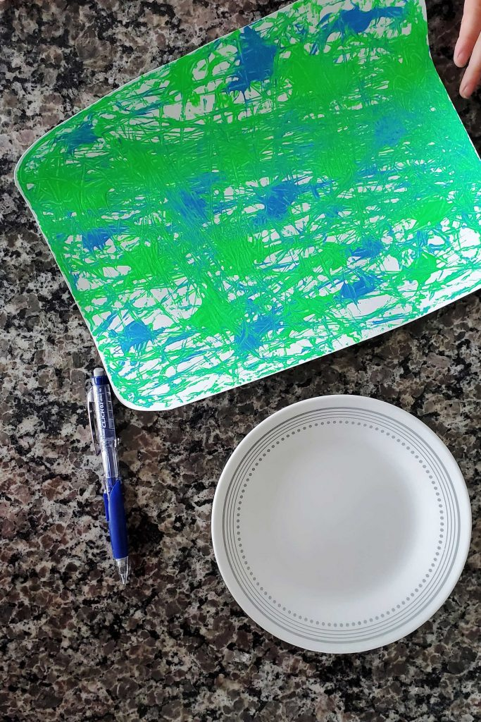 Celebrate Earth Day with this simple marble painting kids craft!  Show your love by adding hearts and displaying them around your home!
