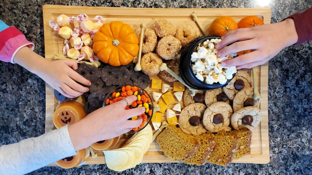 This yummy Halloween charcuterie board is sweet, salty and kid-approved!  Plus get some easy tips for creating a cohesive board.